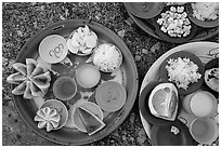 Close-up of food offerings. Kyaiktiyo, Myanmar ( black and white)