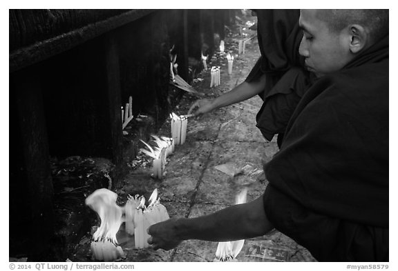 Monks lighting candles. Kyaiktiyo, Myanmar (black and white)