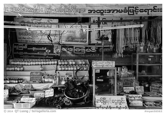 Medicinal shop on the path to the Golden Rock. Kyaiktiyo, Myanmar (black and white)