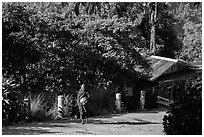 Monk walking barefoot on the path to the Golden Rock. Kyaiktiyo, Myanmar ( black and white)