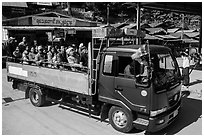 Truck carrying pilgrims to the top of Kelasa Hill. Kyaiktiyo, Myanmar ( black and white)