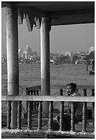 Man fishing on the Chao Phraya river. Bangkok, Thailand (black and white)