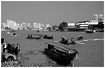 Chao Phraya river crowded with boats. Bangkok, Thailand (black and white)