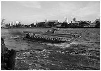 Crowded long tail taxi boat on Chao Phraya river. Bangkok, Thailand (black and white)