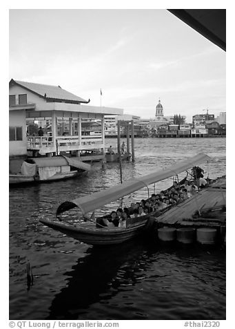Evening commute, long tail taxi boat on Chao Phraya river. Bangkok, Thailand (black and white)