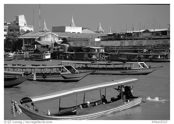 Flotilla of boats on the Chao Phraya river. Bangkok, Thailand (black and white)