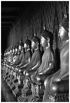 Row of Buddha statues in gallery, Wat Arun. Bangkok, Thailand ( black and white)
