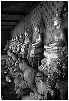 Buddhist monks and buddha statues, Wat Arun. Bangkok, Thailand (black and white)