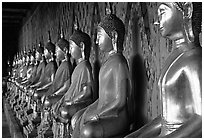 Row of Buddha figures, Wat Arun. Bangkok, Thailand (black and white)