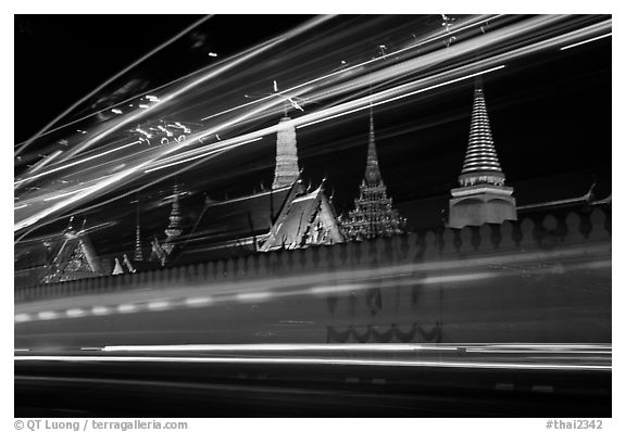 Wat Phra Kaew seen through the lights of traffic. Bangkok, Thailand (black and white)