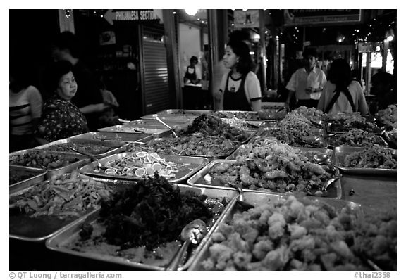 Variety of spicy foods in a market. Bangkok, Thailand (black and white)