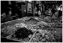 Variety of spicy foods in a market. Bangkok, Thailand ( black and white)