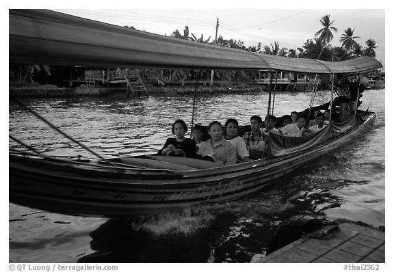 Evening commute, long tail taxi boat on canal. Bangkok, Thailand (black and white)