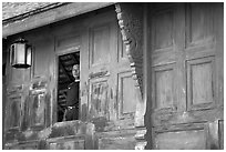 Man at window. Muang Boran, Thailand (black and white)