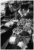 Fruit for sale, floating market. Damonoen Saduak, Thailand (black and white)