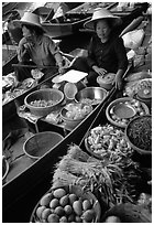 Women selling fruits and vegetables, Floating market. Damonoen Saduak, Thailand (black and white)