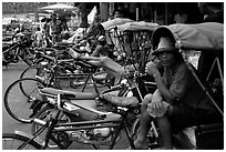 Tricycle drivers. Nakkhon Pathom, Thailand (black and white)