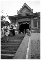 San Phra Kan (Kala shrine), invaded by monkeys. Lopburi, Thailand (black and white)
