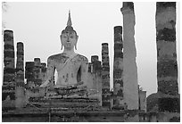 Wat Mahathat, the most important complex of Sukhothai, dusk. Sukothai, Thailand (black and white)