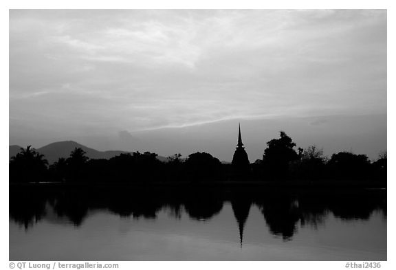 Elegant lines of Wat Si Chum at sunset. Sukothai, Thailand (black and white)