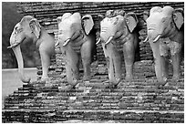Some of the 36 elephants at the base of Wat Cahang Lom. Sukothai, Thailand ( black and white)