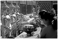 Worshiper makes offering at Wat Phra That Doi Suthep. Chiang Mai, Thailand (black and white)