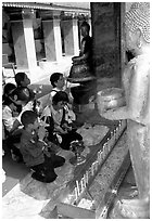 Worshipers at Wat Phra That Doi Suthep, the North most sacred temple. Chiang Mai, Thailand (black and white)