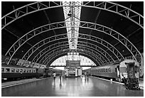 Train platforms inside Hualamphong station. Bangkok, Thailand ( black and white)