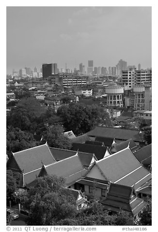Temple rooftop and modern skyline. Bangkok, Thailand (black and white)