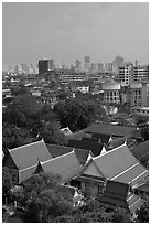 Temple rooftop and modern skyline. Bangkok, Thailand ( black and white)