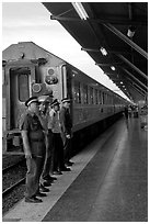 Attendants and train, Hualamphong station. Bangkok, Thailand ( black and white)