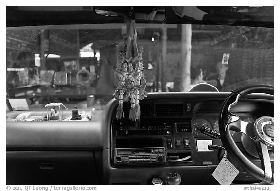 Bus dashboard with religious items. Thailand
