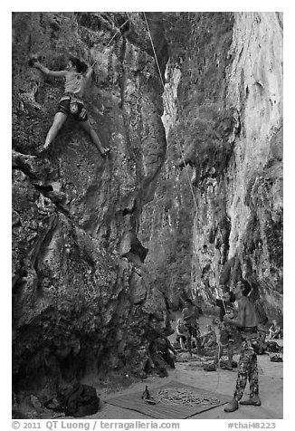 Rock climbers on beach, Ao Railay East. Krabi Province, Thailand (black and white)
