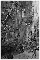 Rock climbers on beach, Ao Railay East. Krabi Province, Thailand ( black and white)