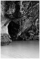 Limestone overhang and turquoise waters, Rai Leh. Krabi Province, Thailand (black and white)