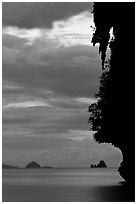 Seascape with limestone islets, stalactite, dusk, Andamam Sea. Krabi Province, Thailand ( black and white)