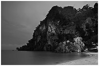 Cliffs and trees at night, Rai Leh East. Krabi Province, Thailand (black and white)