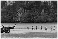 Disembarking at low tide, Rai Leh East. Krabi Province, Thailand ( black and white)