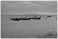 Boats anchored at low tide, storm sky,  Railay East. Krabi Province, Thailand ( black and white)