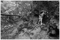 Hiker on steep trail, Laem Phra Nang, Rai Leh. Krabi Province, Thailand (black and white)