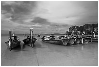 Long tail boats on beach, Hat Rai Leh West. Krabi Province, Thailand ( black and white)