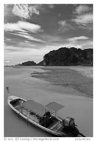 Boat and cliffs, Ao Nammao. Krabi Province, Thailand (black and white)