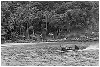 Long tail boat and beach cabins, Ko Phi Phi. Krabi Province, Thailand ( black and white)