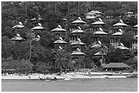Beach and hillside bungalows on stilts, Ko Phi-Phi island. Krabi Province, Thailand (black and white)
