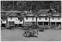 Boats and waterfront houses, Tonsai Village, Phi-Phi island. Krabi Province, Thailand (black and white)