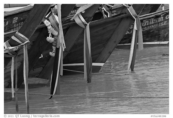 Prows of longtail boats with garlands, Ko Phi-Phi Don. Krabi Province, Thailand (black and white)