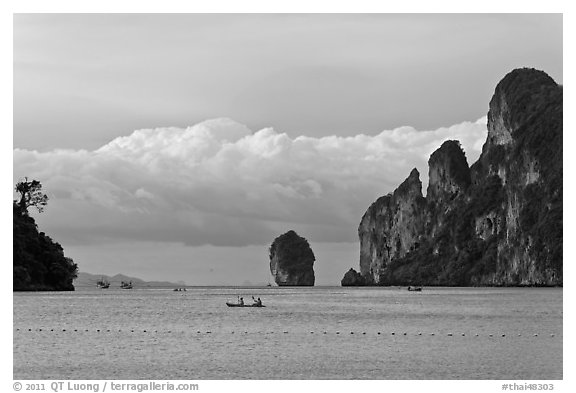Distant boats and cliffs, Lo Dalam bay, Ko Phi-Phi Don. Krabi Province, Thailand (black and white)