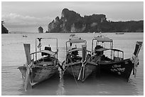 Boats, bay, and cliffs,  Ao Lo Dalam, Ko Phi-Phi island. Krabi Province, Thailand ( black and white)