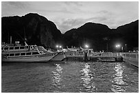 Harbor and cliffs at dusk, Ko Phi-Phi island. Krabi Province, Thailand (black and white)