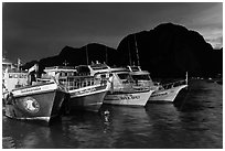 Fishing and tour boats at night, Ko Phi-Phi Don. Krabi Province, Thailand (black and white)